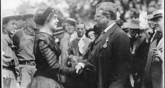 Theodore Roosevelt shakes hands with Silver Dollar Tabor